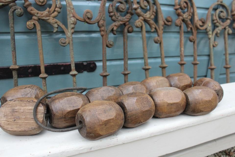 Oude houten drijver