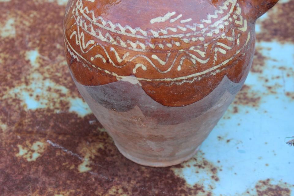 Oude aardewerk sap/wijn karaf