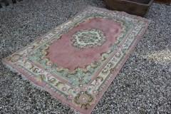 Oud Oosters roze handgeknoopt tapijt